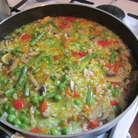 Как только грибы осели, добавляем рис. Перемешать, прогреть рис и добавить бульон. Он должен покрывать рис. Ризотто нужно периодически мешать и подливать бульон. После добавления риса, ризотто готовиться 17 минут. Перед окончание посыпать базиликом, куркумой, попробовать на соль.
