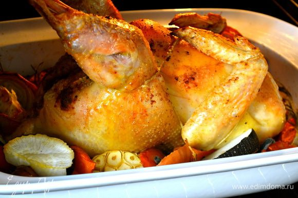 Поставить форму с цыпленком в духовку и сразу же понизить температуру духовки до 200 С. Выпекать от 1,5 ч и может быть чуть больше (до 2-х ч)... все зависит от размеров Вашего цыпленка (курицы). Проверить готовность можно, воткнув в мякоть кончик ножа..., выделяющийся из цыпленка сок должен быть светлого цвета, без крови.