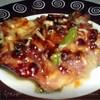 Мясо на луковой подушке,под брусничным соусом