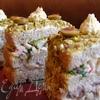 Закусочные «тортики» с сельдью и крабовыми палочками
