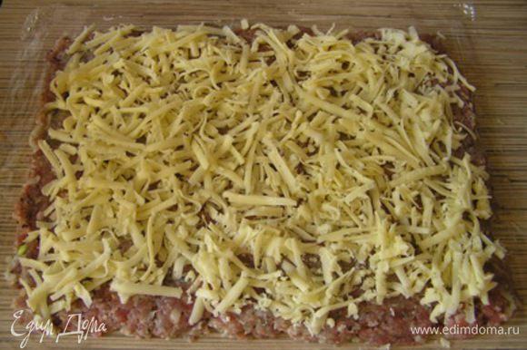 сверху выложить натертый сыр