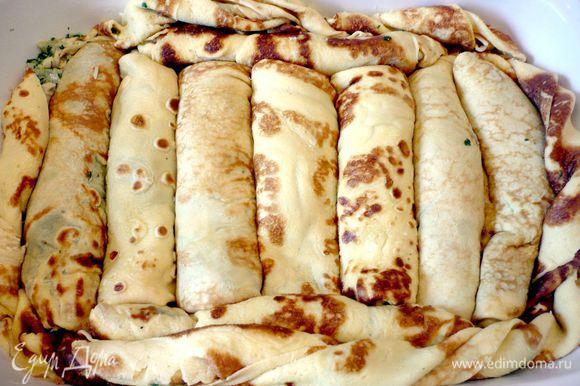 Сложить их плотно рядком в смазанную сливочным маслом форму для запекания.