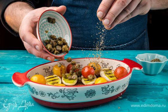 На сковороде-гриль обжариваем помидоры черри и нарезанный лук порей. Кладем рядом со стейком помидоры с луком, добавляем каперсы. Посыпаем майораном.