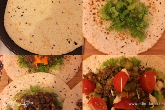 Лепешки прогреть на сковороде без масла, сверху положить салат, мясную начинку, огурцы, черри и полить все соусом (по вкусу).
