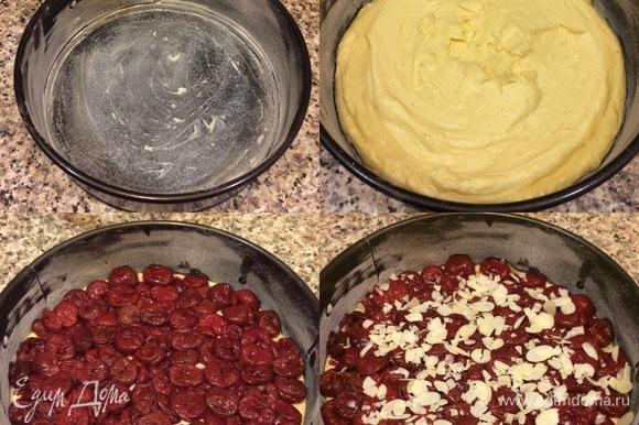 Форму диаметром 20 см слегка смазать маслом и посыпать мукой. Переложить тесто в форму и разровнять. Сверху разложить вишню и слегка вдавить в тесто. Посыпать миндальными лепестками и отправить в духовку.
