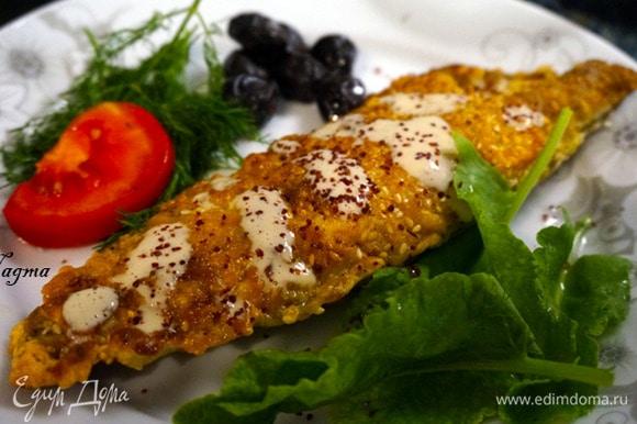 Подавать рыбу с соусом тахини, бабагануш, рисом, булгуром, картофелем, с сезонными овощами и зеленью. Приятного аппетита!