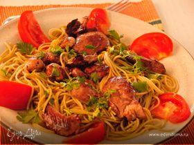 Кроличьи потрошка с чесноком и спагетти
