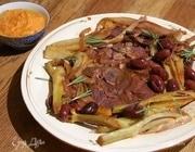 Свинина, томленная с оливками, розмарином и анчоусами