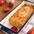 Запеканка из белой рыбы с креветками в томатном соусе